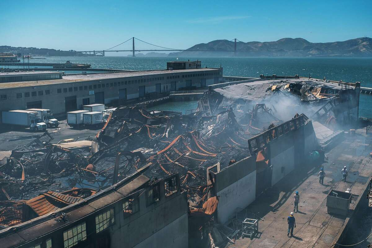 Pier 45 is a ruin after a massive fire in May destroyed Shed C, where fishing and crabbing equipment was stored.