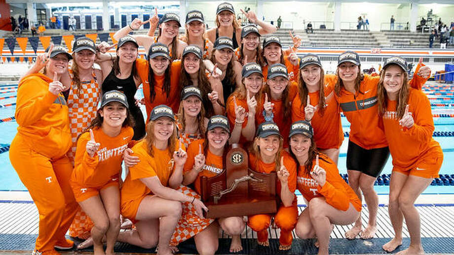 Edwardsville's Bailey Grinter, back row right, was part of the the 2019-20 University of Tennessee Lady Volunteers swim and dive team that was recently named the 2019-20 Tennessee Sports Hall of Fame Female Amateur Team of the Year. The 2020 SEC champions will be among those honored at the Tennessee Sports Hall of Fame induction banquet Aug. 1 in Nashville. Grinter, a junior from Edwardsville High, earned a pair of All-America certificates , as well as three gold medals in relay events at the 2019 SEC meet. The Lady Vols won their first SEC title in February, capping off an 8-0 season. The women finished third nationally in the polls and counted five of their eight wins over teams that finished in the CSCAA top 25 – defeating No. 2 Virginia and No. 12 Georgia in head-to-head meetings and at the Tennessee Invitational. At the SEC Championship meet, the Lady Vols took the championship lead on day two and held onto it for the remaining three days. Tennessee held off a hard-charging Florida Gators squad on the final night to win the SEC title by 29 points – 1,108 for the Lady Vols to second-place Florida's 1,079. UT captured 11 medals – eight gold, two silver and one bronze – en route to its championship. The team of the year award is just the latest honor for the Lady Vols as 15 members of the squad earned CSCAA All-America status with 11 of them being named All-America in multiple events. The women also had 10 members named first and second team All-SEC. Photo: Tennessee Vols Athletics