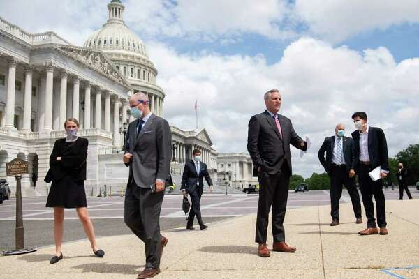 House Minority Leader Kevin McCarthy, R-Calif., center, arrives for a news conference about Republican efforts against proxy voting.