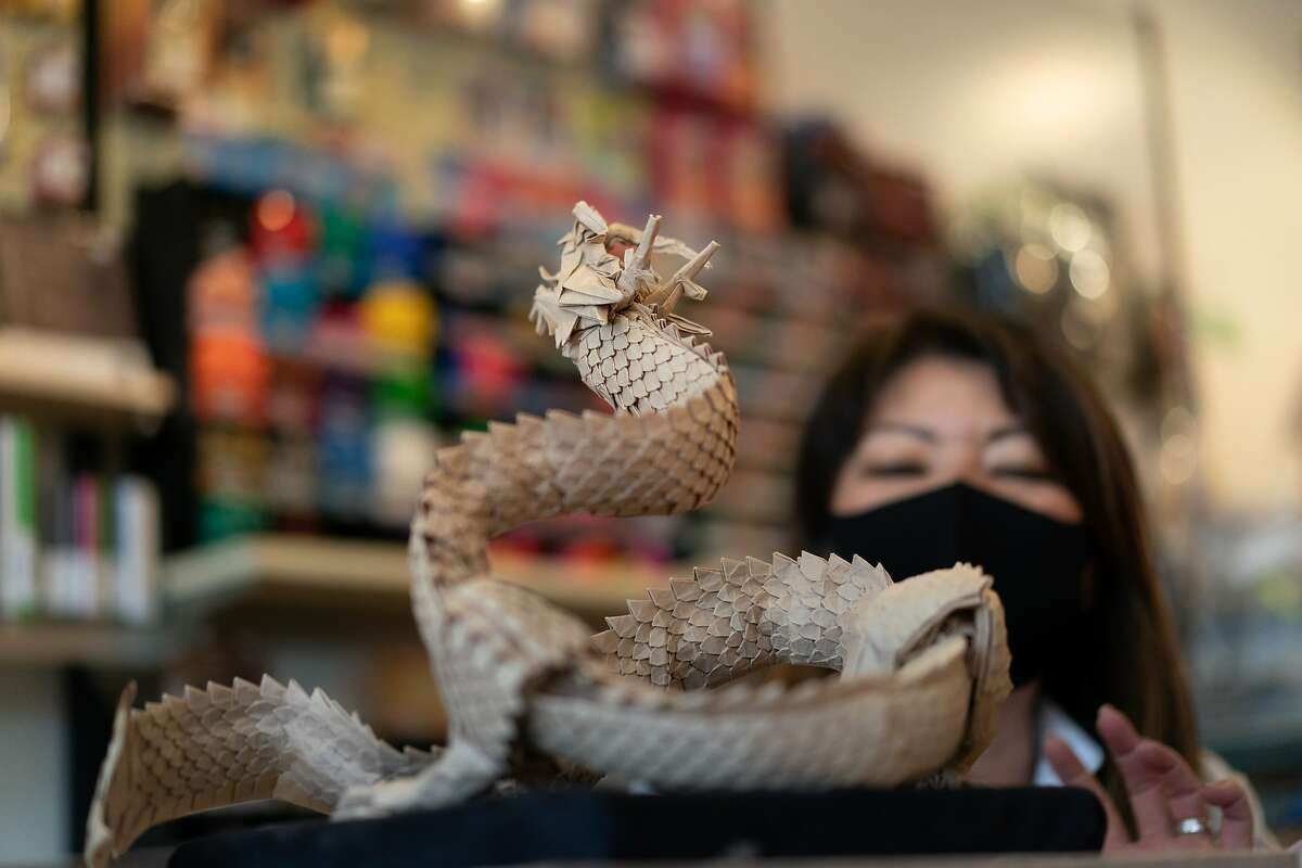 Linda Mihara, owner of an origami shop called Paper Tree in Japantown, shows an origami dragon made from a single 6� x 6� sheet with no cuts by Richard Cam on Monday, May 25, 2020, in San Francisco, Calif.