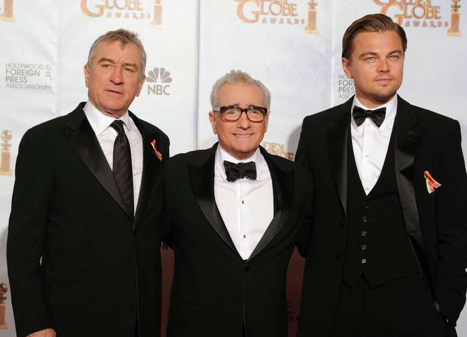 Apple will reportedly help produce Killers of the Flower Moon, a film Martin Scorsese (center) is making with Robert De Niro (left) and Leonardo DiCaprio. Photo: Kevin Winter/ Getty Images