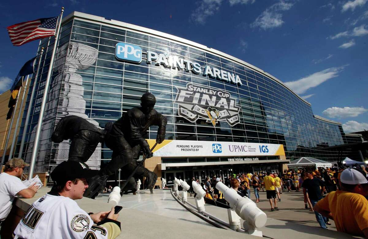 FILE - In this May 29, 2017, file photo, fans wait outside PPG Paints Arena for Game 1 of the NHL hockey Stanley Cup Finals between the Pittsburgh Penguins and the Nashville Predators, in Pittsburgh. PPG Paints Arena is one of the possible locations the NHL has zeroed in on to host playoff games if it can return amid the coronavirus pandemic. The league will ultimately decide on two or three locations for games, with government regulations, testing and COVID-19 frequency among the factors for the decision that should be coming within the next three to four weeks. (AP Photo/Gene J. Puskar, File)