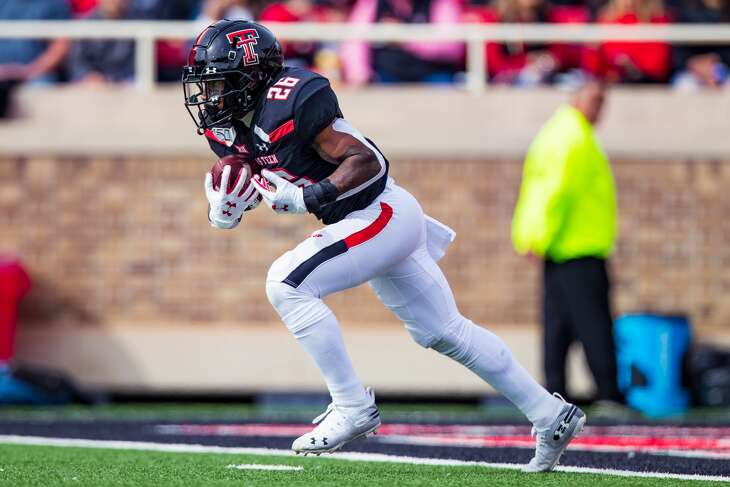 LUBBOCK, TEXAS - NOVEMBER 16: Running back Ta'Zhawn Henry #26 of the Texas Tech Red Raiders returns a kickoff during the first half of the college football game against the TCU Horned Frogs on November 16, 2019 at Jones AT&T Stadium in Lubbock, Texas. (Photo by John E. Moore III/Getty Images)