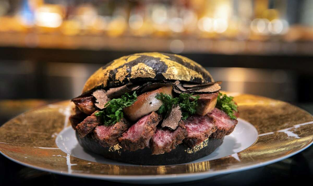 Black Gold at H Bar 1600 W Loop S H Bar, located on the first floor of The Post Oak Hotel at Uptown Houston, is offering a luxe burger with a matching price tag. The Black Gold Burger costs $1,600 and showcases a 16-ounce Japanese A5 wagyu patty, seared foie gras, black truffles and truffle aioli. All on the same burger.But there's more. It's served on a caviar-infused 24-carat black and gold brioche with 24-carat fries and a bottle of 2006 Dom Perignon Champagne.