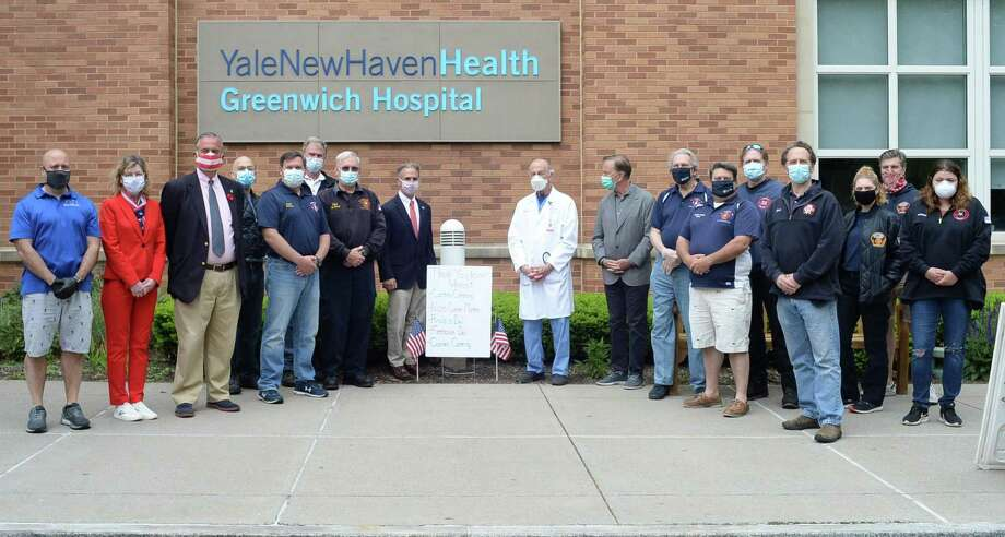 Representatives from Greenwich's volunteer fire companies banded together to pay for and deliver lunch all week to Greenwich Hospital's doctors, nurses and staff. On Monday they were joined by Gov. Ned Lamont, First Selectman Fred Camillo and state Rep. Stephen Meskers at the hospital. Photo: Contributed /