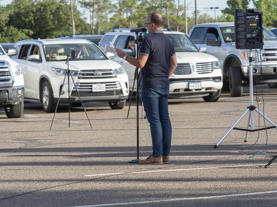 Midlanders come together 05/27/2020 evening for a car-side prayer offered by Mike Goeke and drive around Midland College circle with names of 27 area leaders with the city, county and school districts. Tim Fischer/Reporter-Telegram Photo: Tim Fischer/Midland Reporter-Telegram