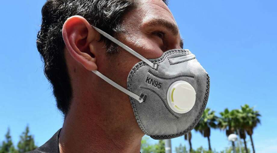 Health care professionals warn that while one-way valve masks protect the person wearing them, they do not prevent the person from spreading the virus to others. Photo: Frederic J. Brown / Getty Images / AFP or licensors