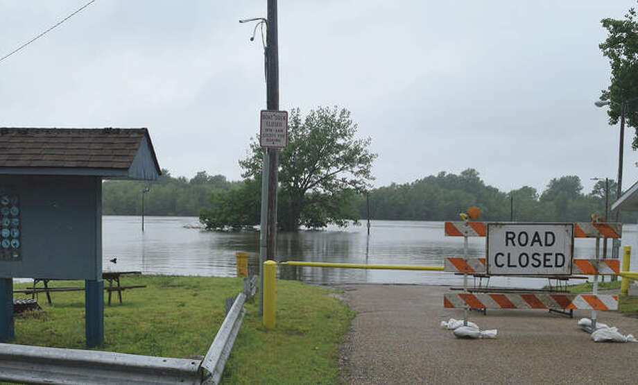 The Illinois River overflows its banks Wednesday in Meredosia after days of rain.