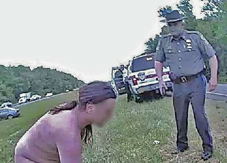 "Connecticut's highest ranking state trooper came to the aid of a naked man on I-84 on Wednesday, May 27, 2020. ""Colonel Stavros Mellekas was on his way to State Police headquarters Wednesday morning when he witnessed a naked man in the median on Interstate 84 in Southington. The man was clearly in distress and creating a potentially hazardous situation,"" state police said. Photo: State Police Photo"
