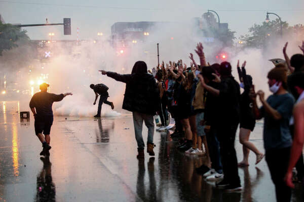 "MINNEAPOLIS, MN - MAY 26: Tear gas is fired as protesters clash with police while demonstrating against the death of George Floyd outside the 3rd Precinct Police Precinct on May 26, 2020 in Minneapolis, Minnesota. Four Minneapolis police officers have been fired after a video taken by a bystander was posted on social media showing Floyd's neck being pinned to the ground by an officer as he repeatedly said, ""I can't breathe"". Floyd was later pronounced dead while in police custody after being transported to Hennepin County Medical Center. (Photo by Stephen Maturen/Getty Images)"
