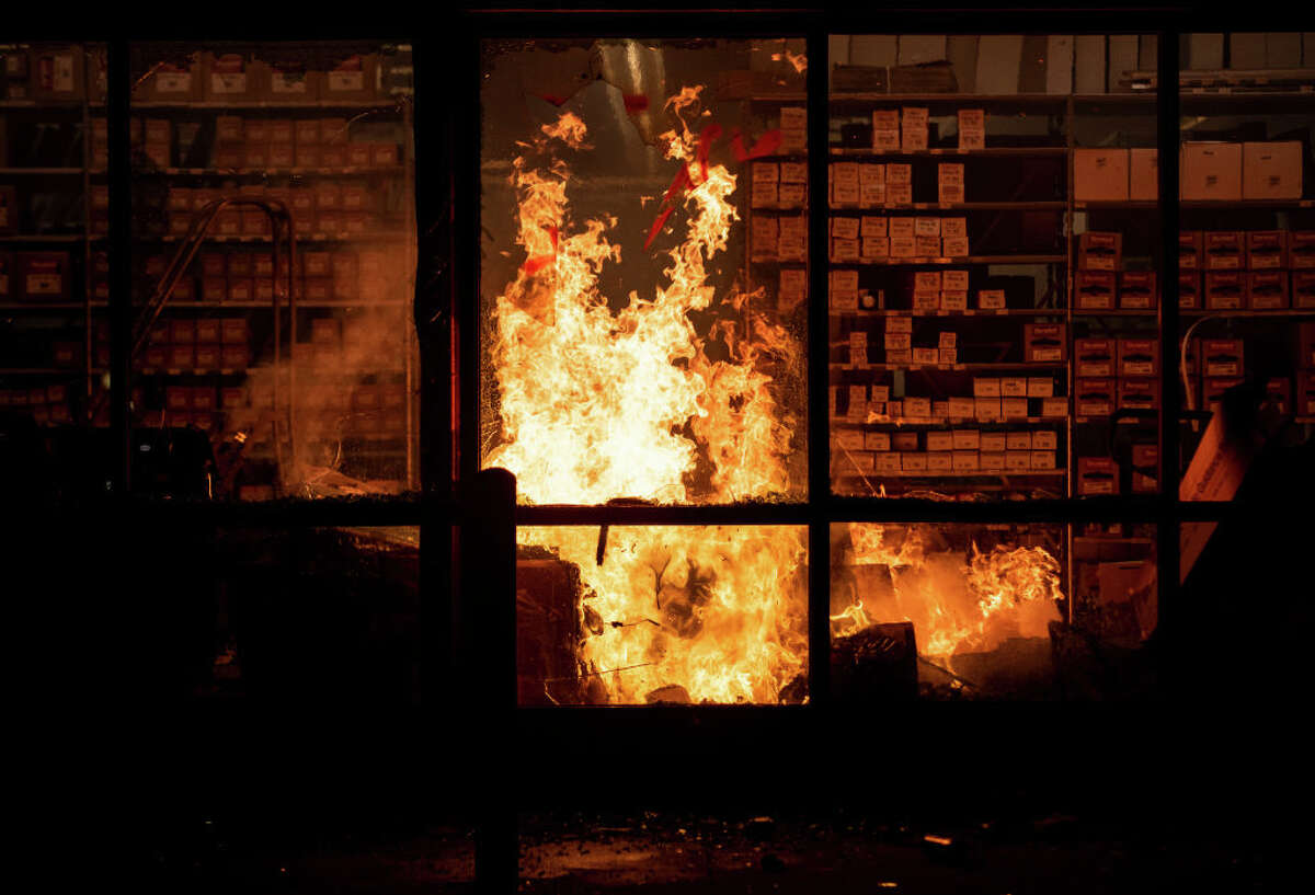 FILE: A fire burns inside of an Auto Zone store near the Third Police Precinct on May 27, 2020 in Minneapolis, Minnesota.