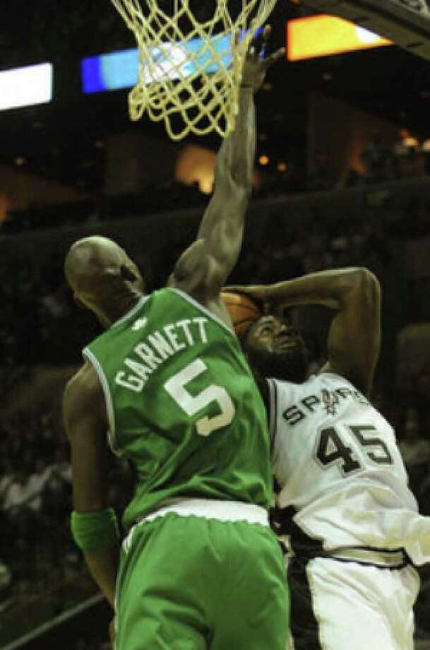 Spurs rookie DeJuan Blair goes up against Boston Celtics forward Kevin Garnett on Thursday. Blair posted a career high of 18 points and added 11 rebounds, but Garnett led Boston to a 90-83 win at the AT&T Center.
