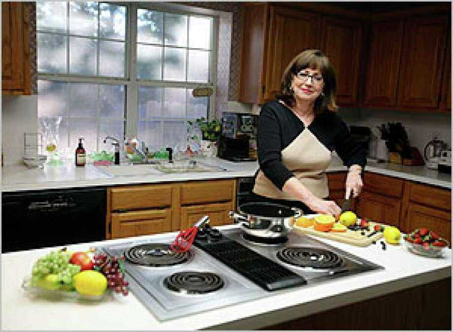 Mary Jane Schreiber has modified the kitchen in her Shavano Ridge home to make it convenient whether she's cooking dinner for two or preparing for 40 party guests.
