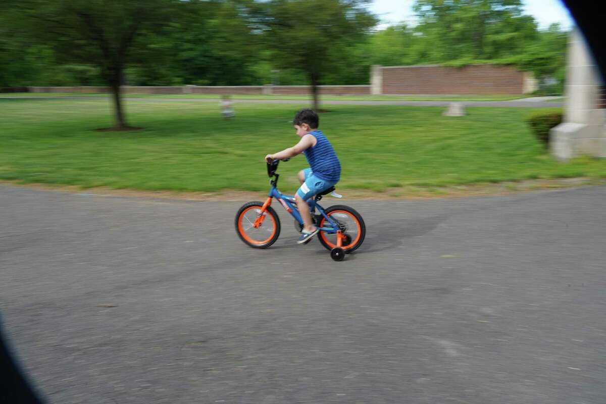 Em Tzortzakis was riding his bike, a birthday present, in front of the Waveny House in New Canaan on Wednesday, May 27, 2020. Business is not as good as it might be for bicycle stores, because there are problems with bicycle distribution, since most bikes come from Asia.