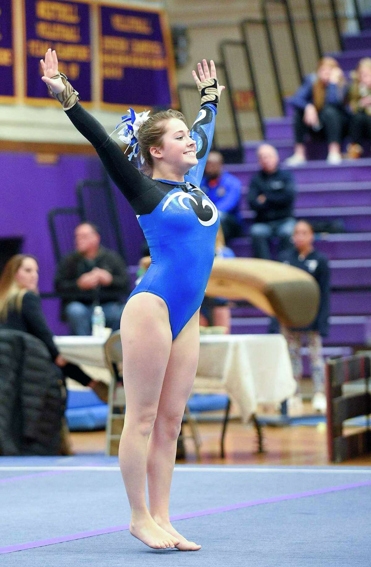 Competitors compete in the Ro Carlucci FCIAC Championship Meet in gymnastics at Westhill High School in Stamford, Conn. on Saturday, Feb. 9, 2019.