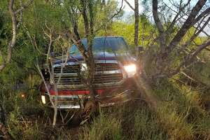 This vehicle was used in a human smuggling attempt. U.S. Border Patrol agents said that the driver drove into the brush when he saw the agents. Further investigation revealed that the vehicle was reported stolen.