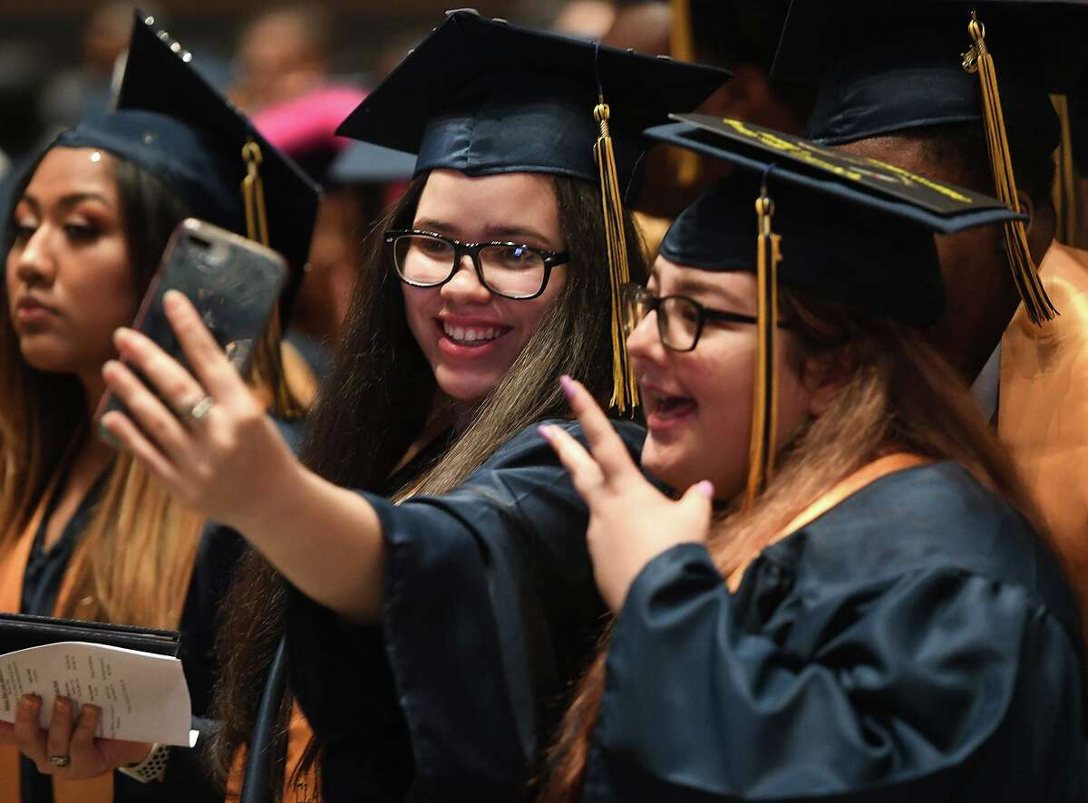 Salutatorian Glorimar Falcon, left, and valedictorian Amanda Tecci pose for a selfie during the Bridgeport Military Academy Commencement at Harding High School in Bridgeport on June 18, 2019. This year's graduation will take place June 18 from 9 to 11 a.m.