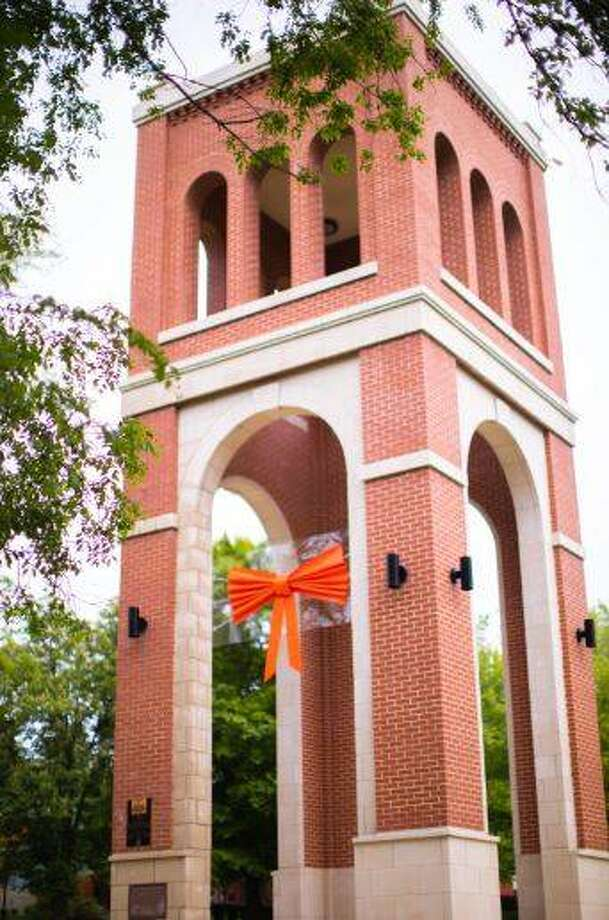 An orange bow will remain tied to Hogue Tower at Greenville University this summer as a reminder of community unity. School officials announced Thursday that in-person classes will resume at the school this fall.