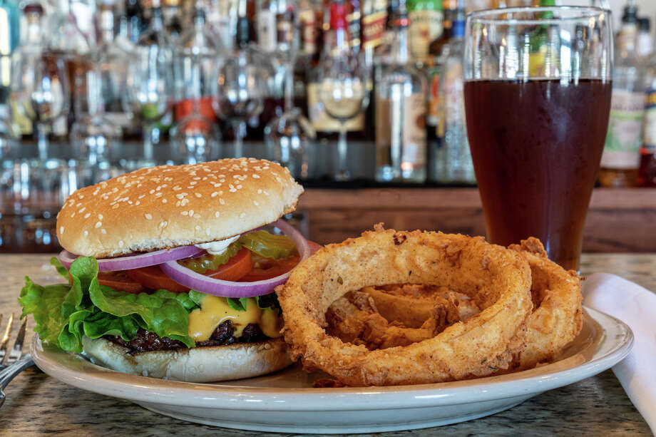 Eugene's Gulf Coast Cuisine has a burger special for National Burger Day. Photo: Bill Maxy / Bill Maxey