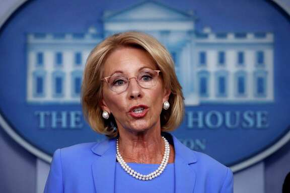 U.S. Education Secretary Betsy DeVos, pictured in March, has drawn criticism from some public school advocates for her administration's guidance on how to distribute federal coronavirus relief funds to private schools. DeVos says part of the funds should go to private schools based on their total enrollment, while opponents of her interpretation argue that the money should be allocated based on private schools' enrollment of low-income students.