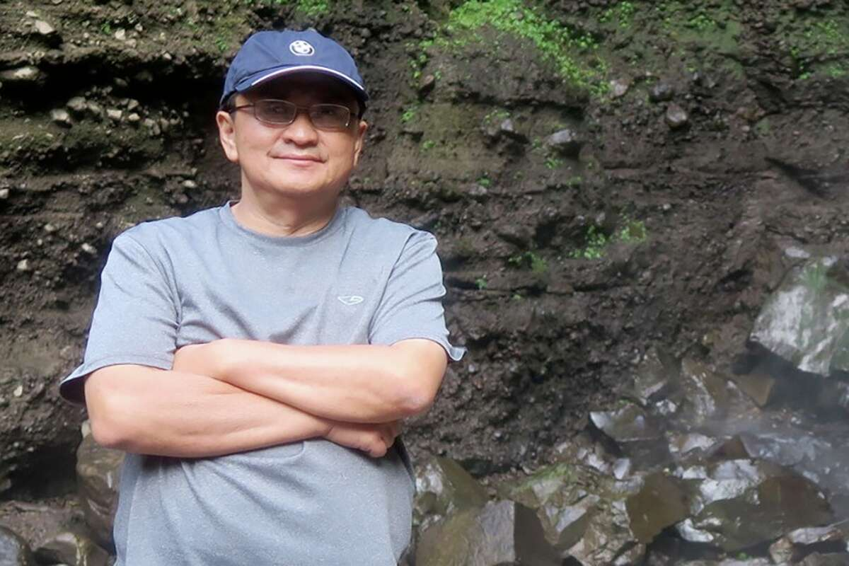 Harry Sentoso in front of a waterfall during a 2016 family trip back to his hometown of Malang, Indonesia.