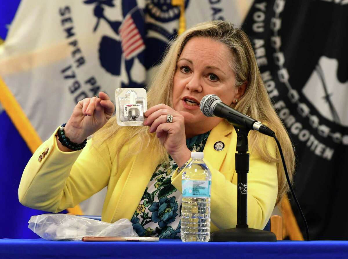 Albany County Health Commissioner Dr. Elizabeth Whalen holds up a Naloxone nasal spray she keeps in her purse during Albany County Executive Daniel McCoy's daily coronavirus briefing on Thursday, May 28, 2020 in Albany, N.Y. She explains how to use the nasal spray that helps reverse an opioid overdose. (Lori Van Buren/Times Union)