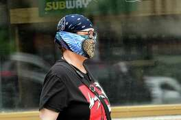 A pedestrian is seen wearing a mask on Thursday, May 28, 2020 in Albany, N.Y. (Lori Van Buren/Times Union)