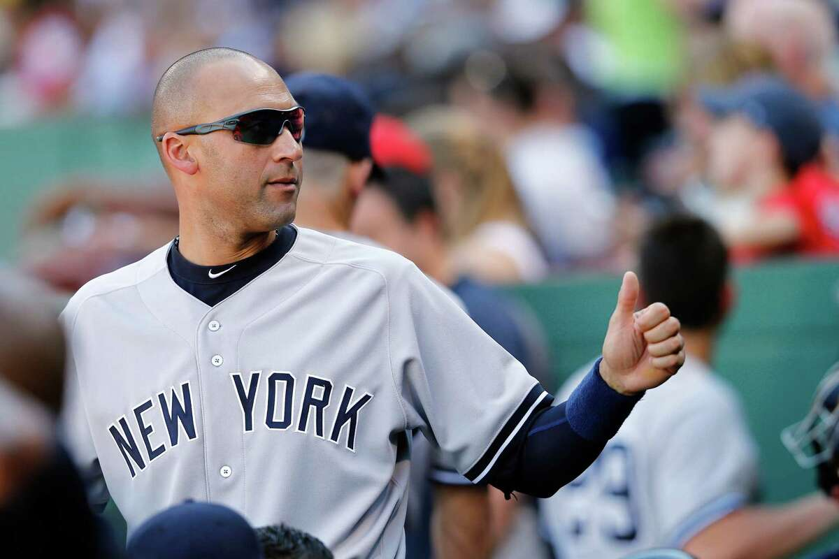 BOSTON, MA - SEPTEMBER 27: Derek Jeter #2 of the New York Yankees looks on from the dugout against the Boston Red Sox during a game at Fenway Park on September 27, 2014 in Boston, Massachusetts. (Photo by Jim Rogash/Getty Images) ORG XMIT: 477590689