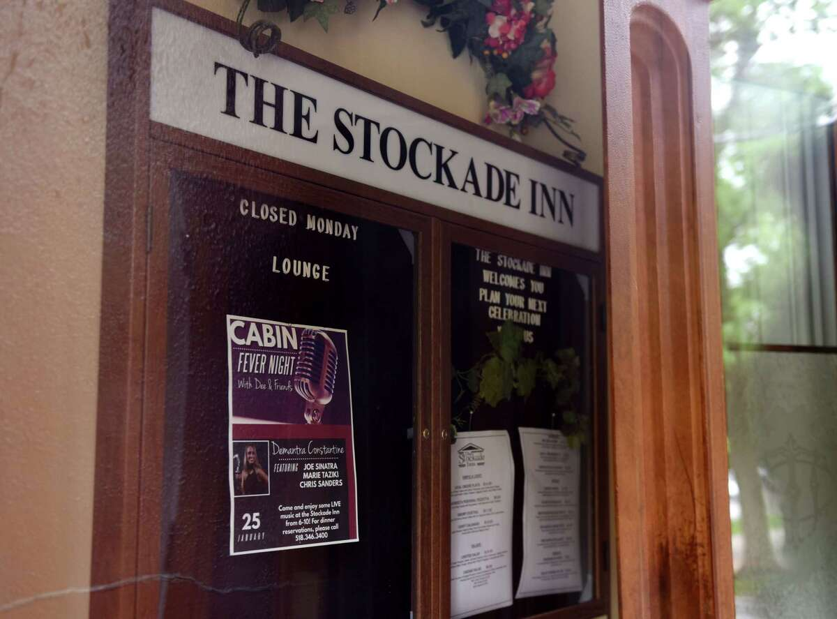 Signs in the doorway of the Stockade Inn date back to when the venue was once open on Thursday May, 28, 2020, on in Schenectady, N.Y. Redburn Development is negotiating to buy the now-shuttered Stockade Inn in Schenectady with a plan to turn the building boutique hotel and restaurant into apartments and offices. (Will Waldron/Times Union)