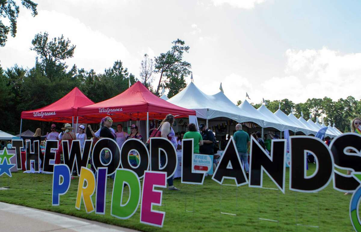 People enter The Woodlands Pride Festival on Saturday, September 28, 2019 at Town Green Park in The Woodlands.