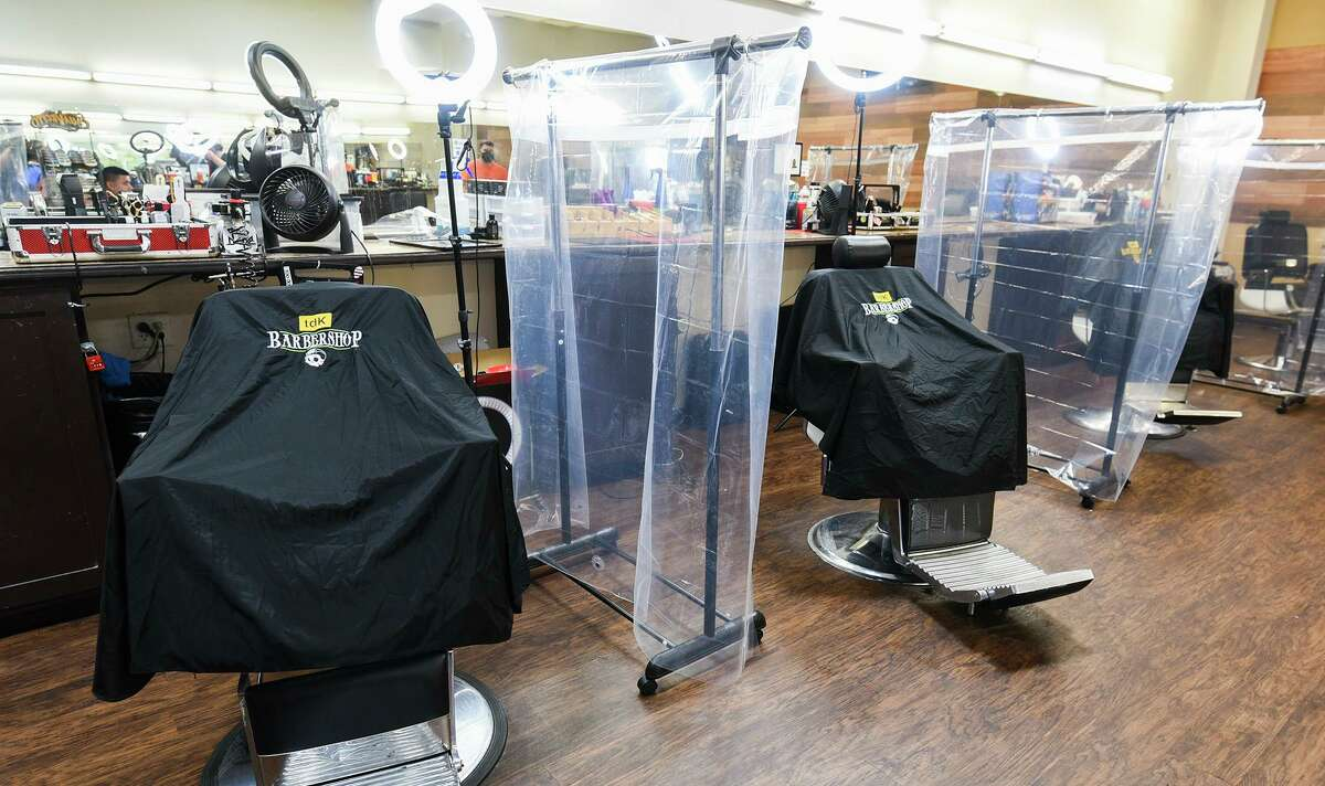 TDK's barber stations are divided with plastic sheets to address COVID-19 coronavirus concerns, Wednesday, May 27, 2020 at Mall Del Norte.