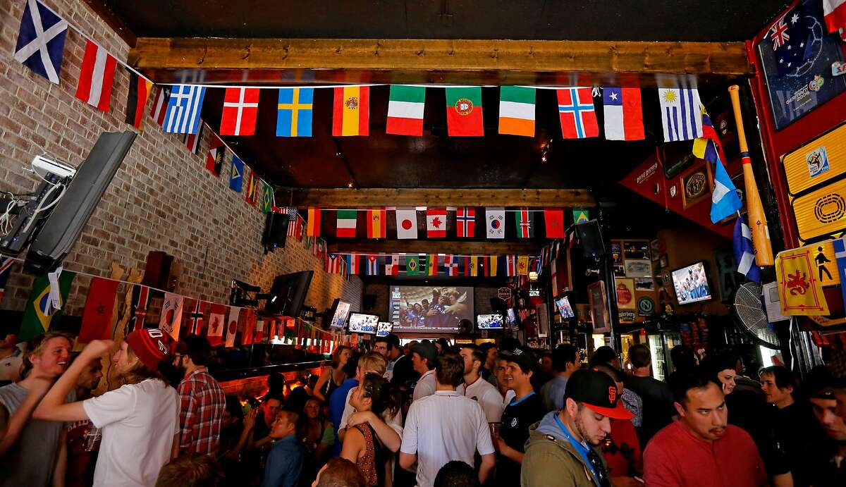 """Fans pack """"The Mad Dog in The Fog"""" bar as they wait for the 2014 World Cup match between England and Italy to begin, on Saturday 14, 2014, in San Francisco , Calif."""