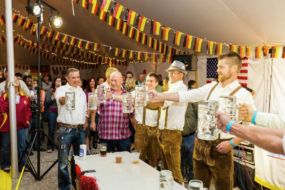 A group of beer drinkers raise their Stein glasses for a toast during a previous Big Rapids Germanfest celebration. This year's festivities have been cancelled amid ongoing concerns of the coronavirus. (Courtesy photo)