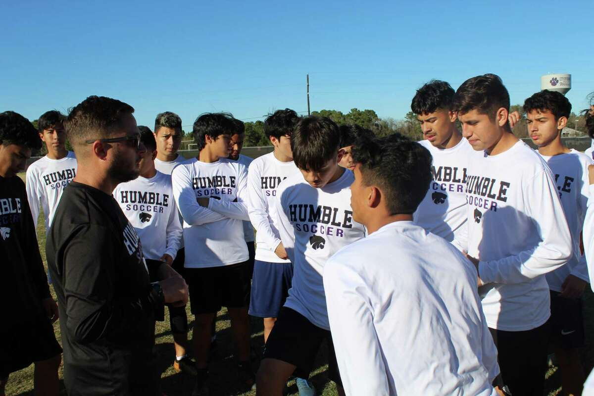Humble coach Saul Keene adressing the Wildcats before practice on the soccer field.