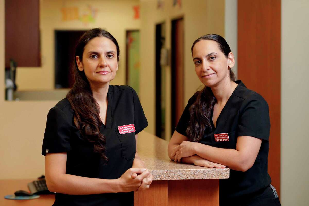Doctors and sisters Sogol, left, and Silen Pahlavan, right, at the offices of their practice ABC Pediatrics Clinic Friday, May. 22, 2020 in Houston, TX. The two own the practice and have declined to take their salaries in order to pay their staff's full salaries.