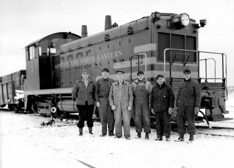 One of the train crews from the M.N.&E. railroad is shown in this photograph from the 1940s.
