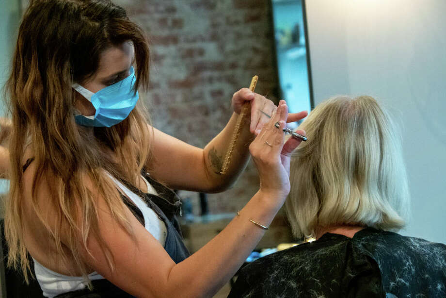 As salons in Washington prepare to open in Phase 2, major changes have been made to comply with the state's new guidelines. Click through the gallery to see some of the new policies and procedures you can expect at your next haircut. >>> Photo: Photo By Jason Whitman/NurPhoto Via Getty Images / Jason Whitman/NurPhoto