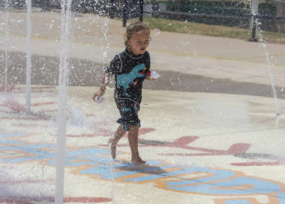 Nixin Barnhart runs down the middle of the fountains Thursday at the splash pad at Security Bank Ballpark. The splash pad is open 1-7 p.m. daily, except on Wednesdays, when it will be closed for maintenance.Entry will be from the ballpark's southeast gate. The area will be monitored by city staff, who will allow entrance to a maximum of 30 people (25 percent of capacity). Children under 14 must be accompanied by an adult. Guests will be expected to practice social distancing; stand 6 feet apart. Restrooms will not be open, and food and drinks – except water – are not allowed.  Photo: Tim Fischer/Midland Reporter-Telegram
