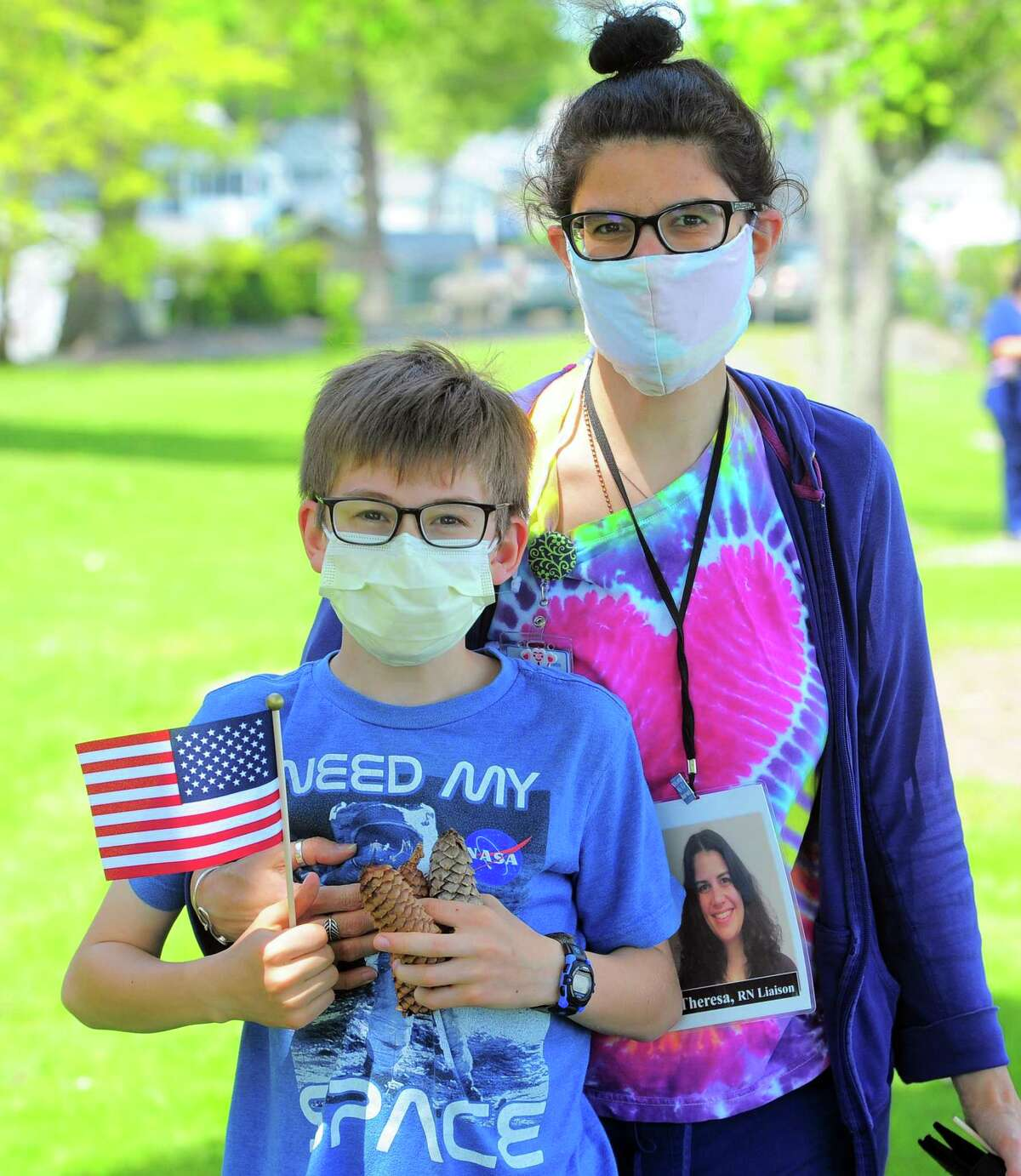 Theresa Razmakhnin and her son Dmitri, 12, attend the Thank You Tour which made a stop at Connecticut Hospice in Branford, Conn., on Wednesday May 27, 2020. The tour was held as a way to come together to enjoy this very special respite from all we are enduring as individuals, as families, as an organization, as a community, and as a nation.