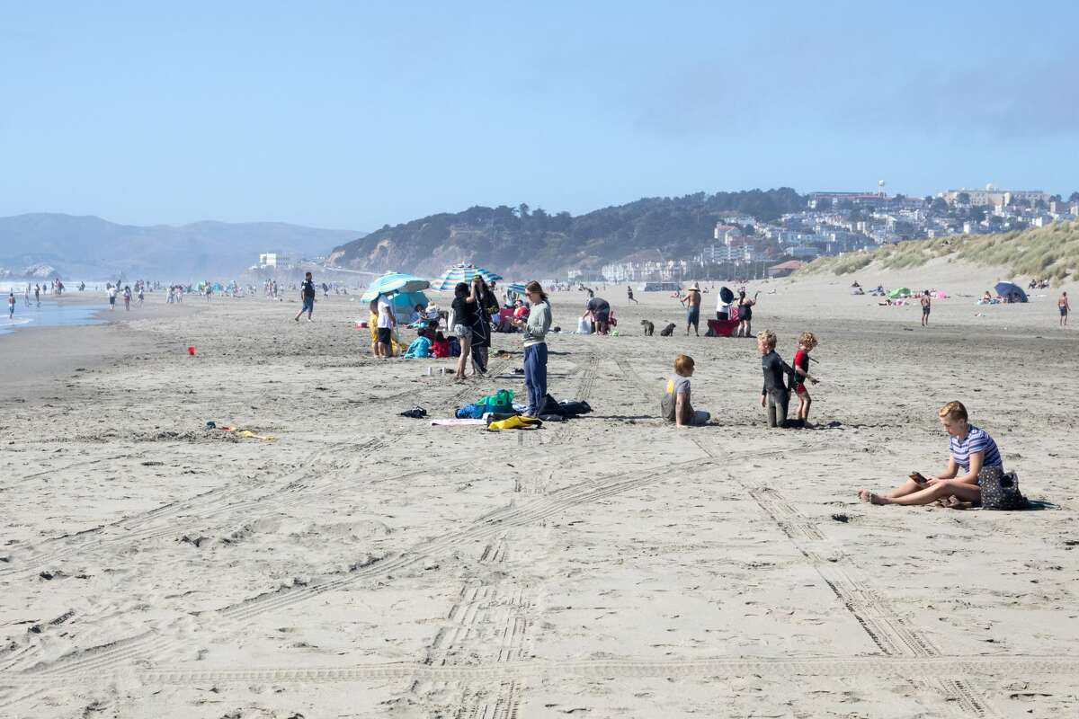 People enjoy the weather at Ocean Beach. Comparing 200, 50, and 24 mm views from camera in San Francisco, Calif. on May 27, 2020.