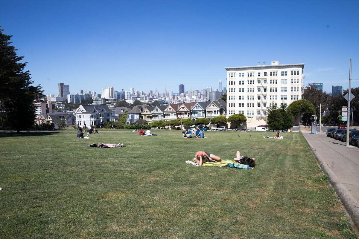 People relax at Alamo Square. Comparing 200, 50, and 24 mm views from camera in San Francisco, Calif. on May 27, 2020.