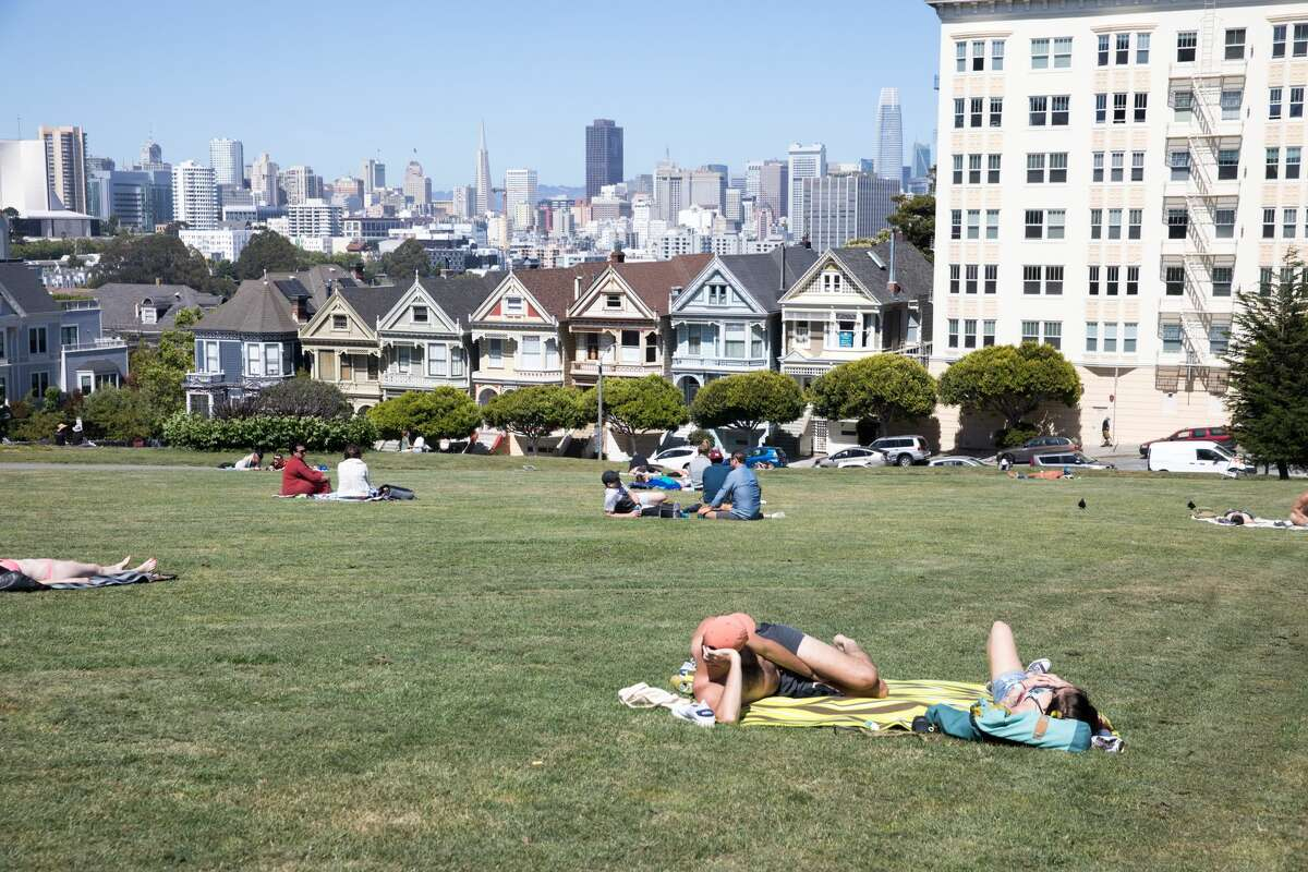 People relax at Alamo Square in San Francisco on May 27, 2020.