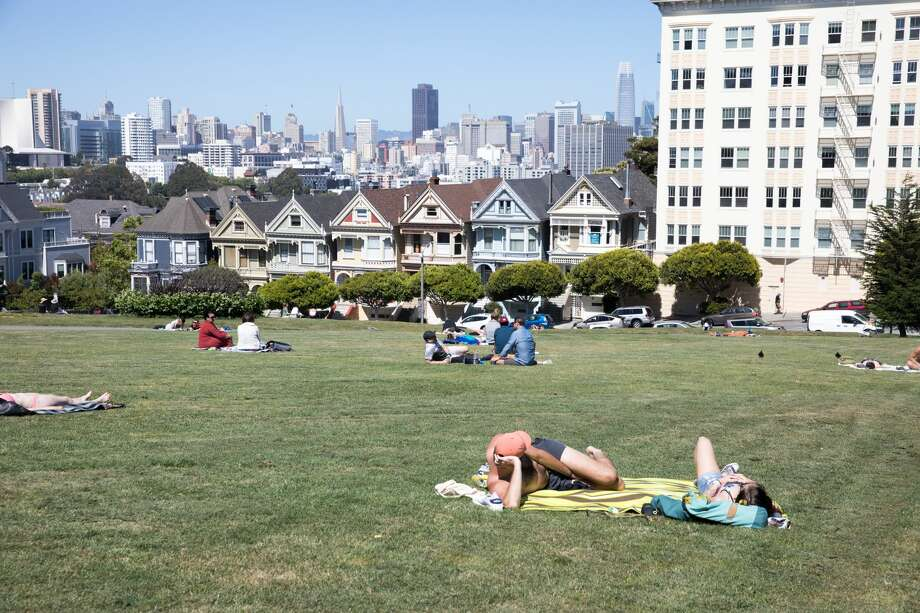 People relax at Alamo Square in San Francisco on May 27, 2020. Photo: Douglas Zimmerman/SFGate / SFGate