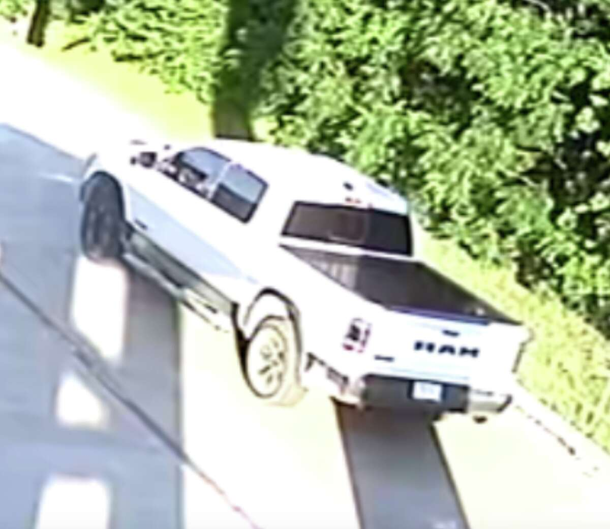 Officials shared photos of a pickup truck seen fleeing the scene after a man was shot and killed at the Super 8 Motel on Roland Ave.