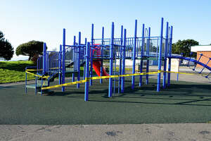 Caution tape wraps the playground gym at Sunset Ridge Elementary School in Pacifica. San Mateo schools have detailed a plan for reopening this fall.