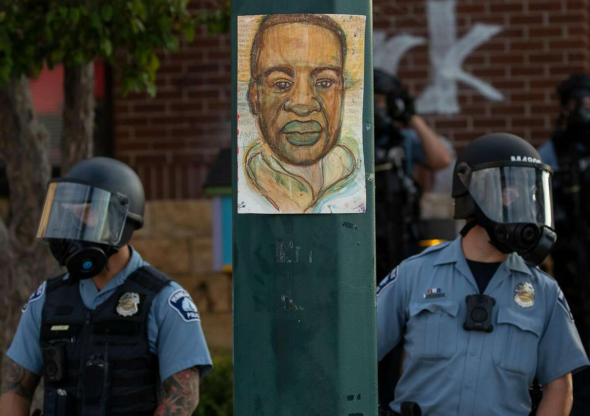 Protests continue on Wednesday, May 27, 2020, at the Minneapolis 3rd Police Precinct following the death of George Floyd in a confrontation with Minneapolis police on Monday evening. (Carlos Gonzalez/Minneapolis Star Tribune/TNS)