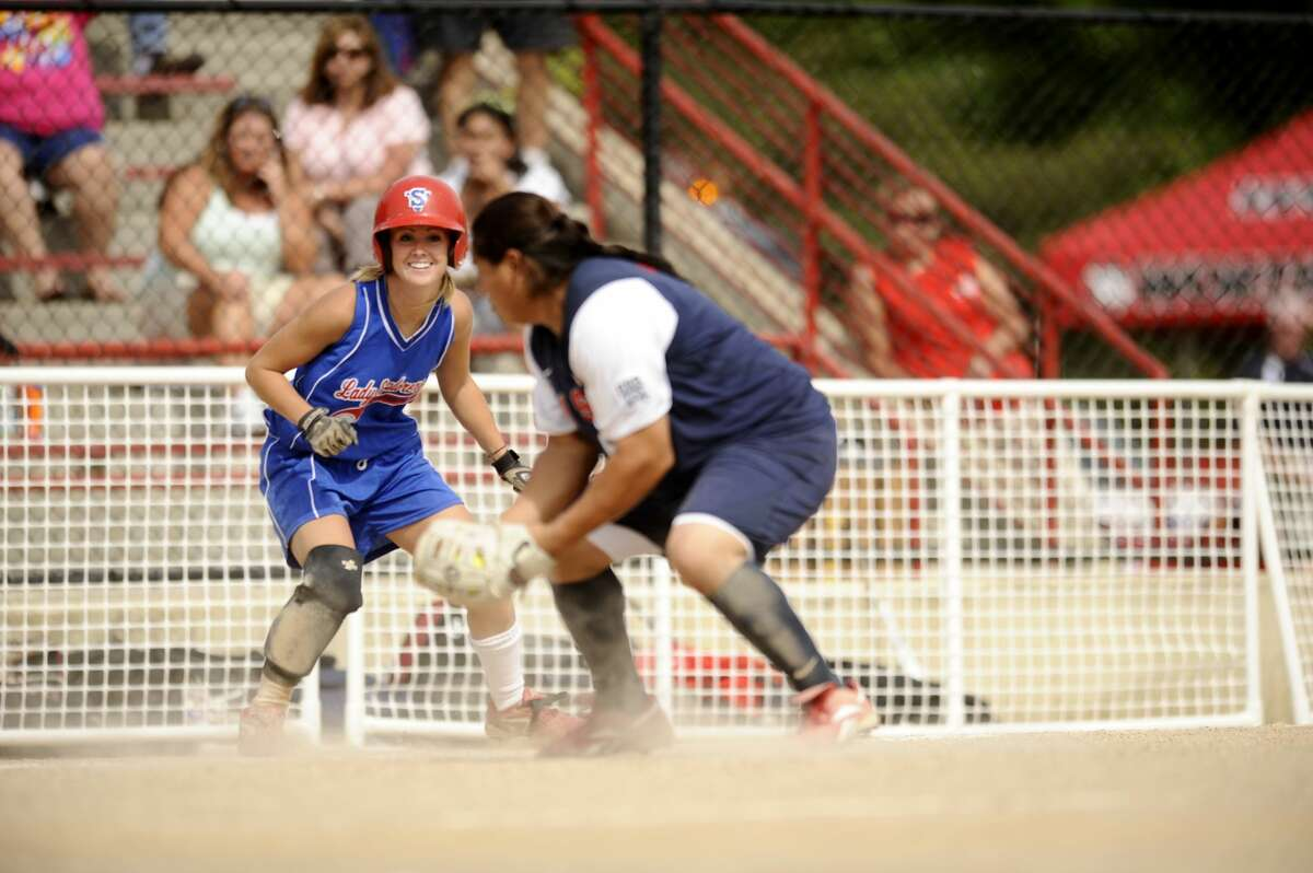 Lady Explorers' Stefani Morong is looked back to third base by Team USA's Crystl Bustos during a June 21, 2008 exhibition game at Currie Stadium.