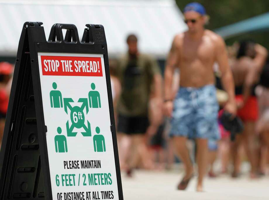 A sign urges guest to stay six feet apart at Big Rivers Waterpark, Saturday, May 23, 2020, in New Caney. The waterpark open for the season following Gov. Greg Abbott's start of Phase 2 reopening of the economy that began Friday. Photo: Jason Fochtman, Houston Chronicle / Staff Photographer / 2020 © Houston Chronicle