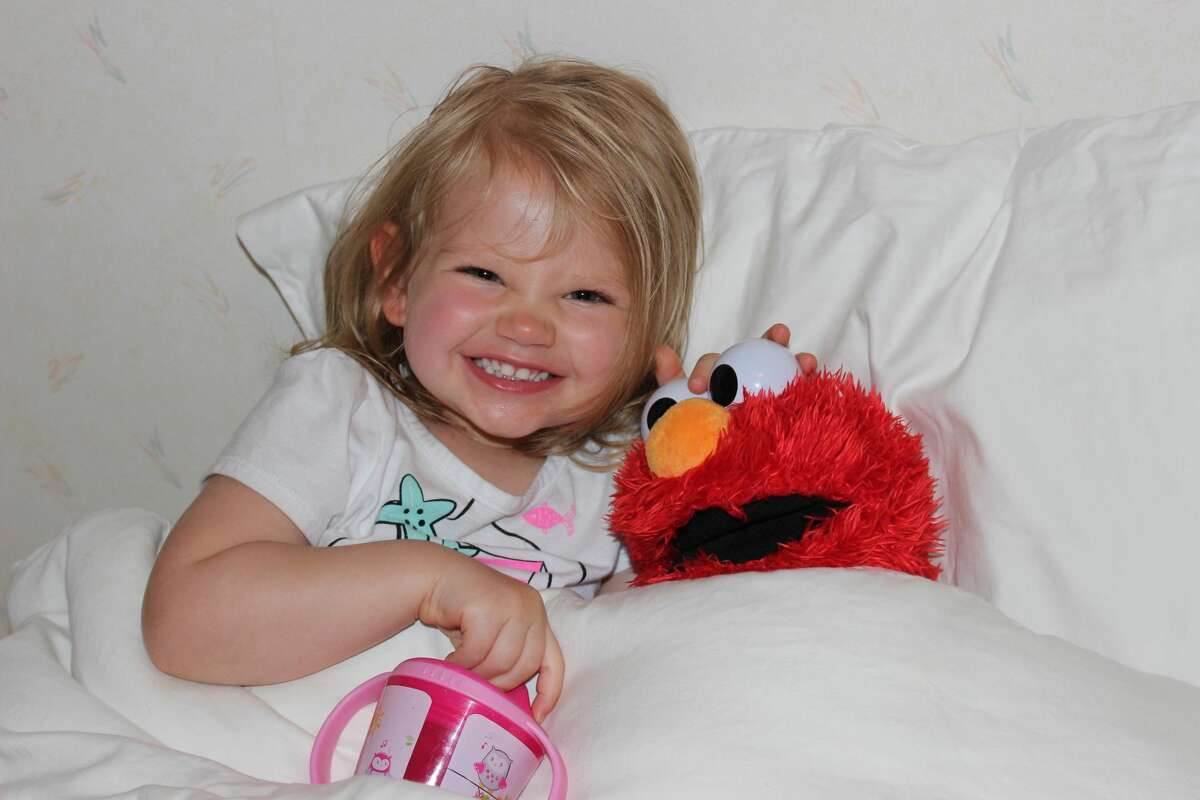 Two-year-old Kyra Franchetti with her beloved Elmo doll.