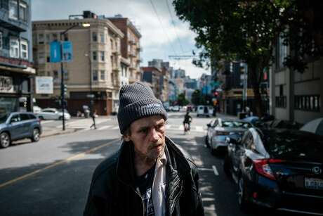 Jeff Reaves, a homeless man, pauses on the street while walking to his tent in the tenderloin on Friday April 10, 2020.